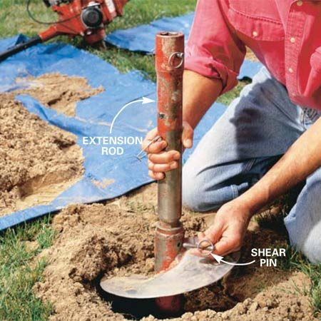 <b>Photo 5: Using an extension rod</b></br> Extend holes past the normal 36-in. limit by using an extension rod. First dig all the holes without the extension, then leave the auger in the last hole, extract the shear pin and lift off the power head. Then mount the extension bar and remount the power head with a second shear pin.