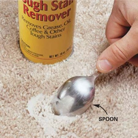 <b>Photo 3: Scrub in carpet cleaner</b></br> Spray carpet cleaner on the stain and scrub it into the carpet with a spoon. Dab it dry with a clean white towel, then let the carpet air-dry (it will appear slightly darker until completely dry). Light-colored carpets and dark stains may require several scrubbings.