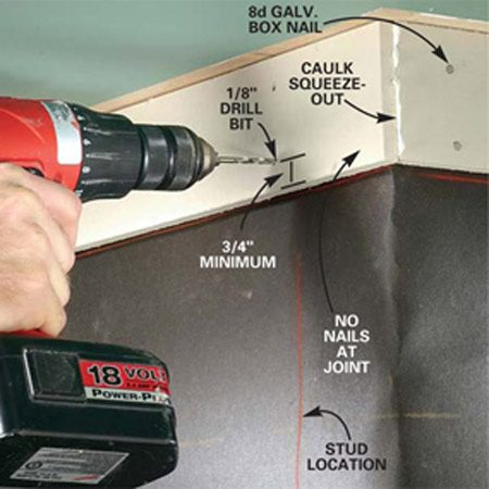 <b>Photo 4: Predrill holes for easy installation </b></br> Predrill and nail the frieze boards, driving two galvanized box nails into each stud. Hold the nails at least 3/4 in. from the edges. Drive the nailheads snug with the surface of the siding. Do not overdrive them. Apply caulk at the corner lap joint before installing the second piece.
