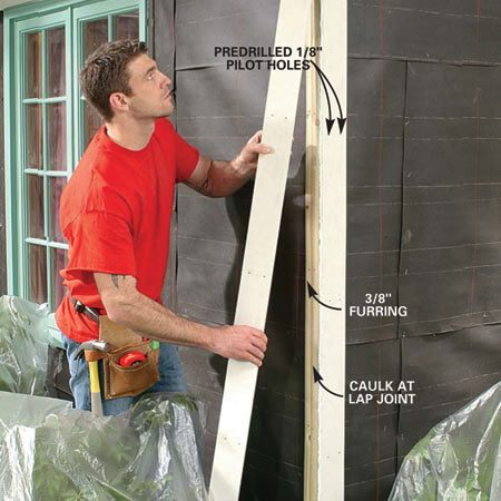 <b>Photo 5: Nail up the corners boards</b></br> Install the corner boards, lapping one over the other with caulk in the joint. Nail every 16 in. with a pair of 8d galvanized box nails.