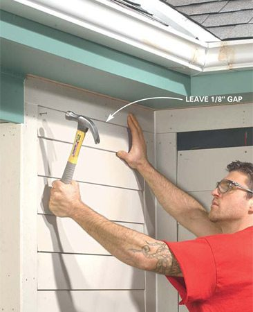 <b>Photo 12: Cut and install the top course of siding</b></br> Cut the top course of siding to width and nail at each stud. Leave a 1/8-in. gap at the top edge. Fill all 1/8-in. gaps with acrylic latex caulk.