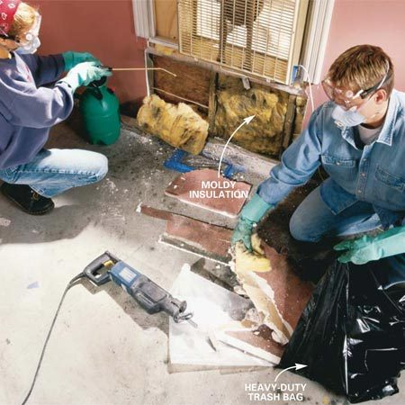 <b>Photo 4: Moisten and then bag moldy materials</b></br> Turn off the electrical power to the room and cut open the damaged wall with a reciprocating saw, drywall saw or utility knife. Mist the moldy drywall and insulation with the pump sprayer to avoid spreading mold spores. Double-bag moldy material in heavy-duty plastic bags and tie them shut.
