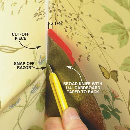 <b>Photo 12: Wrap the corner</b></br> Wrap the paper around the corner, leaving the wrapped side loose and smoothing out the other. Trim off the paper with a sharp razor knife, leaving 1/4 in. wrapped around the corner. Guide the cut with a broad knife built up on one side with 1/4-in. thick cardboard taped to the knife. Book the cut-off piece for later use.