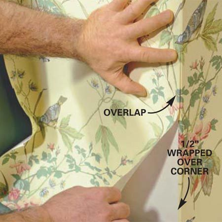 <b>Photo 14: Wrap the outside corner</b></br> Wrap the paper around an <em>outside</em> corner and trim it off, leaving 1/2 in. wrapped. Set a new plumb line if you're continuing on a long wall. Overlap the next piece, holding it 1/8 in. away from the corner.