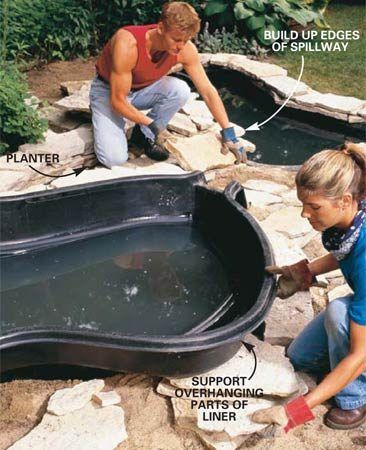 <b>Photo 9: Add stone</b></br> Continue to add stone to support the ledges of the upper pond. Create the walls and base of the canal leading to the lower pond at the same time. The planter area creates a stable surround as well as a more natural-looking transition between upper and lower ponds.