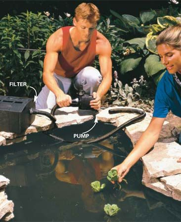 <b>Photo 13: Install the pump and filter</b></br> Connect the filter, pump and hose. Place the lower pond pump and the upper pond inlet hose as far from each other as possible. This will help ensure a more thorough water filtration and minimize stagnation. Keep a careful eye on the water level for several days to make sure there are no leaks or clogs.