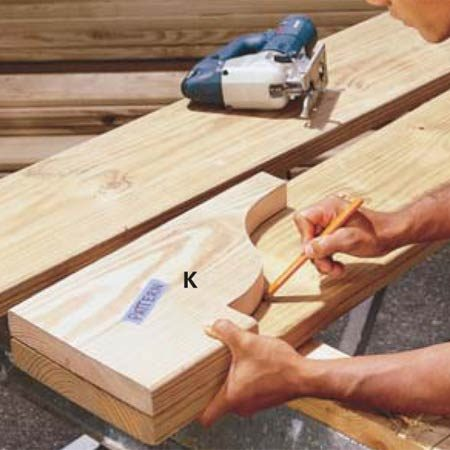 <b>Photo 15: Mark and cut the rafter tails </b></br> Cut the decorative rafter tails from treated 2x10 pine. To avoid cupping, choose knot-free boards and keep them out of the sun until you paint or stain them.
