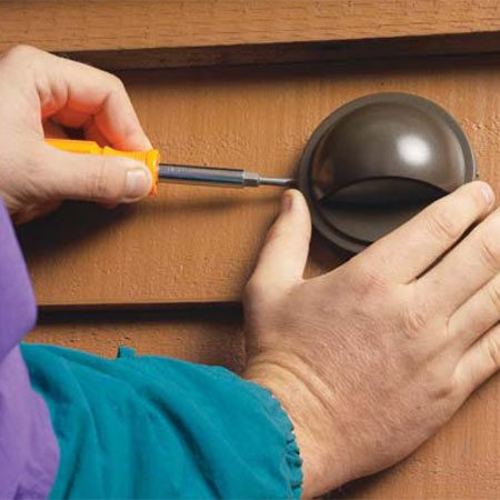 <b>Photo 3: Mount the cover</b></br> Install the cover plate and tighten the set screws. Staple the wires somewhere on the backside to anchor them.