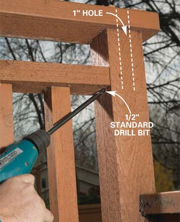 <b>Photo 5: Drill an intercept hole</b></br> Drill a 1/2-in. hole from below the rail. Angle up to intercept the 1-in. hole bored in Photo 4.