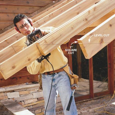 <b>Photo 17: Cut the rafter ends</b></br> Transfer the rafter tail length from the house rafter to the outermost rafter and snap a chalk line to that mark. Draw the 1-in. end cut with a square and the level cut on both sides of each rafter using a 2- or 4-ft. level. Make the rafter tail square cuts first with the circular saw, then make the horizontal level cuts.
