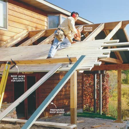 <b>Photo 18: Deck the roof</b></br> Lay the first course of tongue-and-groove roof decking with the groove side facing downhill flush with the rafter ends. Nail the roof decking into one rafter of each rafter pair with two 10d nails. Select lengths so butt seams fall randomly throughout the ceiling. Halfway to the peak, check to make sure the boards are running parallel to the ridge beam. If they're not, adjust the next few courses slightly to fix the problem.
