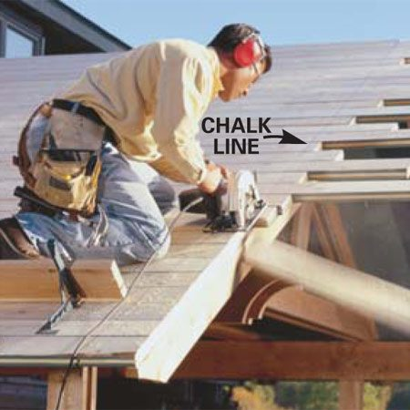 <b>Close up</b></br> Snap a chalk line flush with the edge of the fascia board and cut off the decking ends with a circular saw.