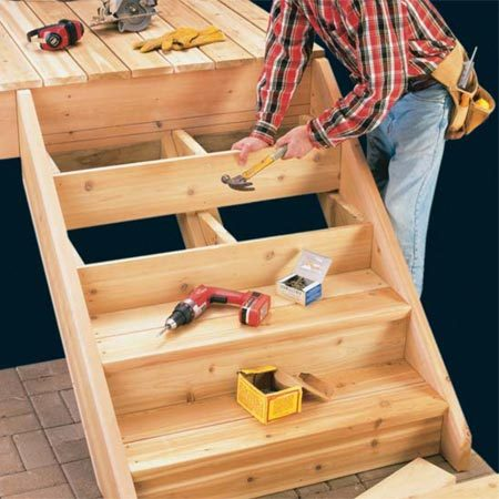 How to build deck stairs the family handyman for How to frame a house step by step