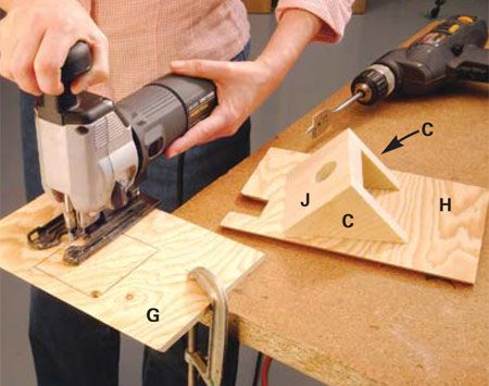 <b>Photo 5: Cut a roof opening</b></br> Cut an opening into the front roof panel (G) for access through the dormer. Drill a 3/8-in. starter hole in two opposite corners to start the cut easily. Cut the chimney opening in the rear roof panel with the blade set at a 45-degree angle.