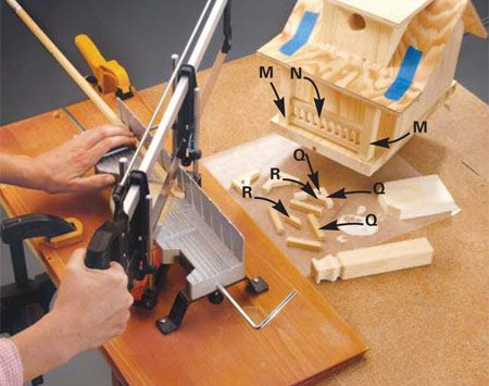 <b>Photo 9: Add the decorative brackets</b></br> <p>Cut the small roof bracket pieces (Q and R) and assemble them using exterior wood glue.</p> <p> <strong>Tip:</strong> Use wax paper under the pieces during assembly to keep them from sticking to the workbench. Once they're assembled, glue them to the sides of the birdhouse. Next, drill the vent holes to keep the birdhouse cool, and finally, select and apply an exterior finish.</p>