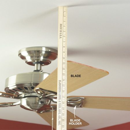 <b>Photo 1: Make sure the blades are straight</b></br> Measure the distance from the ceiling to the edge of a blade with a yardstick (most blades are angled, so be sure to measure on the same side of all the blades). Hold the yardstick stilland rotate the blades around to measure the other blades.
