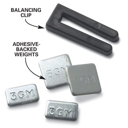 <b>Photo 3A: Balancing kit close-up</b></br> The balancing kit contains the blade clip plus several adhesive-backed weights.