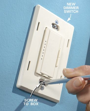 <b>Photo 8: Attach the cover plate</b></br> Fold the wires neatly into the box. Screw the dimmer to the box with the screws provided. Finish the job by installing the cover plate and turning on the power to test the new dimmer.