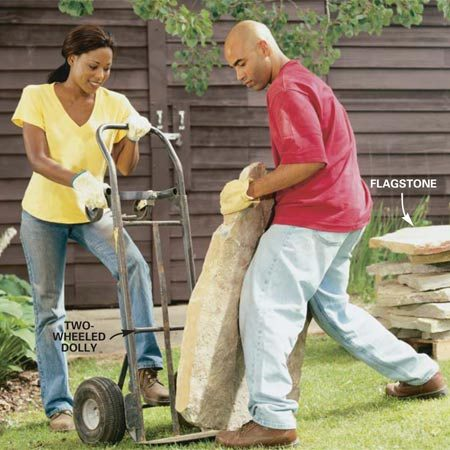 <b>Photo 5: Use a dolly for heavy stones</b></br> Move heavy flagstones by tipping them up on end and rocking them onto a two-wheeled dolly. Keep your back straight and lift with your legs.