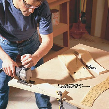 <b>Photo 2: Cut the curved pieces</b></br> Clamp the seat support parts to the workbench to keep them from wandering while you cut the curves. Follow the pattern in Fig. A to accurately copy the curves for the seat frames as well as the arms. Sand along the curves after cutting.