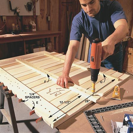 <b>Photo 5: Fasten the back slats</b></br> <p>Lay all the back slats face down on a flat surface and slip temporary 1/4-in. spacers between the slats. Fasten the bottom brace (E) to the middle slat, using a framing square to make sure they're joined at 90 degrees.</p>