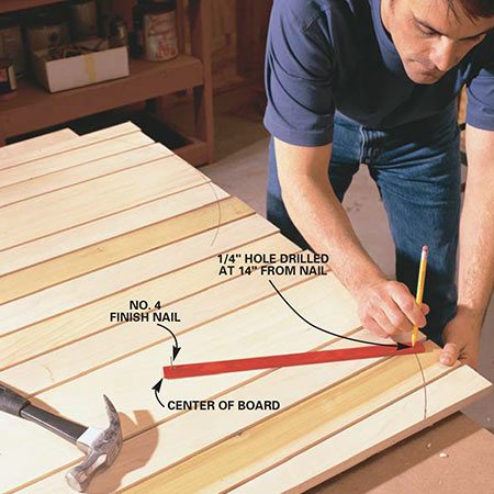 <b>Photo 6: Cut the top curves</b></br> <p>Trace the top curves on the front side of the back assembly using a simple homemade beam compass. Nail one end of the compass 14 in. from the top and in the center of the 1x6 back slat. Insert your pencil into the 1/4-in. hole drilled in the other end of the compass. Cut along the mark with your jigsaw.</p>