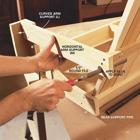 <b>Photo 8: Fit the pipes</b></br> <p>Cut and drill the pipes (Fig. A) and slide them into the holes. File the inside of the 7/8-in. hole in the arm support (M) with a coarse half-round file if the support pipe won't easily slide through. The rear support pipe should fit snugly under the center back brace (F) as it protrudes through each arm support.</p>