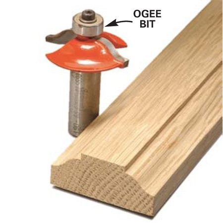 <b>Finished molding and router bit</b></br> A good set-up and steady push result in a smooth, burn-free molding.