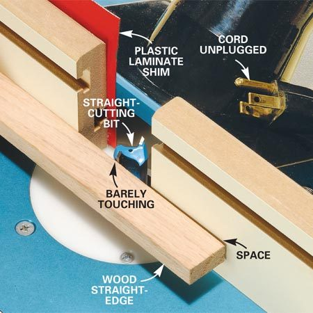 <b>Photo 3: Set the fence</b></br> <p>Plane  straight edges. Shim out the left half of the fence with a piece of  plastic laminate or thin cardboard. Lay a straight board across the shimmed-out  fence and against the router bit. Adjust the fence position until the bit just  touches the straightedge. Spin the bit by hand to make sure it barely touches  at its deepest cut. </p> <p><strong>Caution:</strong> Make  sure the router is unplugged. Don't touch the sharp edge of the bit!</p>