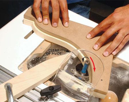 <b>Photo 6: Smooth a rough edge</b></br> Move the work piece away from the pivot while maintaining moderate pressure against the router bit bearing. Move the work piece at a steady rate in a right to left, or clockwise, direction.