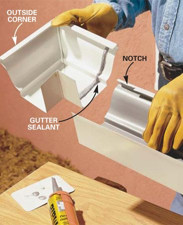 <b>Photo 3: Add sealant and assemble</b></br> Lay a bead of gutter sealant along the corner 1-1/2 in. back from the edge. Hook the front lip of the corner over the notched section of gutter and snap it over the gutter.