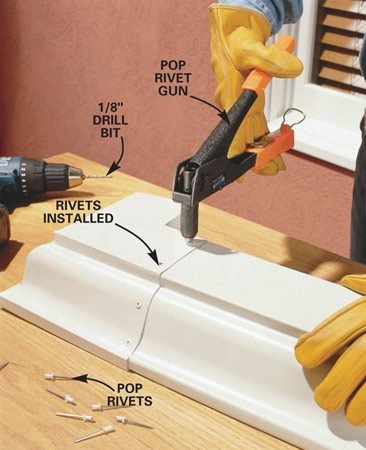 <b>Photo 4: Rivet the joint</b></br> Join the gutter to the corner with six rivets in the locations shown. Start by drilling a 1/8-in. hole (for 1/8-in. rivets) at the front of the gutter and installing the first rivet with the rivet gun. Now drill the remaining holes and install the rivets.