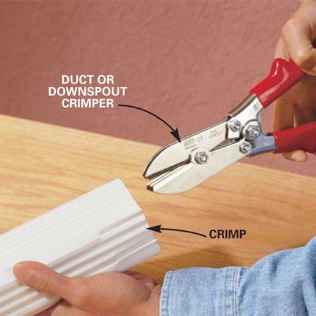 <b>Photo 14: Crimp cut ends</b></br> Crimp one end of the short length of downspout with a special sheet metal crimper. With the three blades on the inside of the tube, hold the crimper against the inside corner of the tube and squeeze. Crimp three times across both long edges and twice on the narrow sides. Attach this short section of downspout to the two elbows with two 1/4-in. hex head sheet metal screws into each joint.