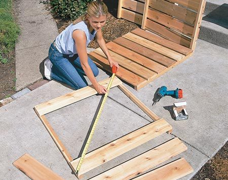 <b>Photo 1: Cut the boards</b></br> <p>Cut the 6-ft. boards into twenty-four 3-ft. lengths. Predrill screw holes and attach two of the 3-ft. boards to a pair of cleats with 2-in. deck screws. Square the frame by moving it until the two diagonal measurements are equal. Spread the remaining boards between the top and bottom boards so they're spaced evenly and screw them in. Repeat this procedure for the other three side panels and the back. To divide the bin into three sections, complete the back panel by screwing on two additional 2x2 cleats.</p>