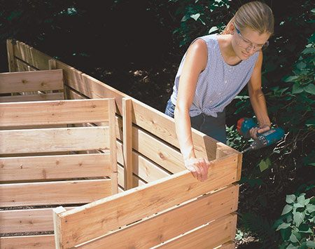 <b>Photo 2: Join the panels</b></br> <p> Assemble the bin by driving 2-in. deck screws through the back boards into the side panels, one screw for each board. Then drive 3-in. deck screws through the 2x2 cleats on the back panel into the 2x2 cleats on each side panel. If uneven ground makes it difficult to align the sections, place shims at the low spots.</p>