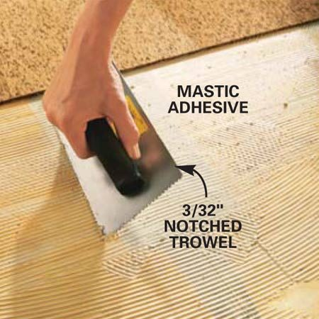 Spreading a mastic-type adhesive