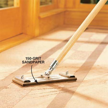 <b>Photo 9: Sand off high spots</b></br> Sand any small high spots or ridges with a drywall sander using 100-grit sandpaper followed by 150-grit paper. Vacuum the entire floor twice.