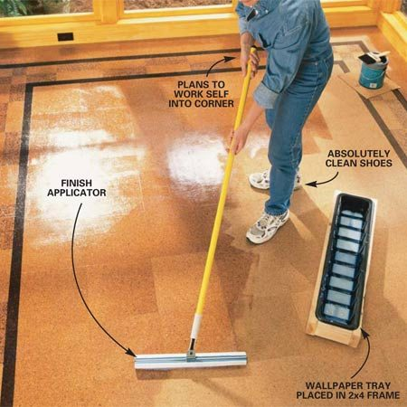 <b>Photo 10: Apply the finish</b></br> Spread your first coat of waterborne polyurethane using a wide applicator available at your flooring supply store or home center. Brush in the corner and edges first with a 4-in. paint brush. Keep a wet edge and avoid puddling the finish. Pull the applicator over the wet area very lightly to smooth the finish. Wait two to three hours and apply another coat. Two full-strength coats will be adequate. Let the finish cure for several days before you bring in the furniture and heavy traffic.