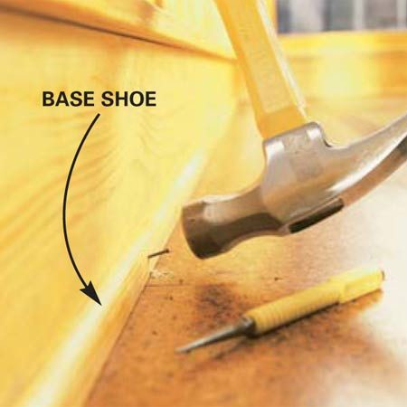 <b>Photo 12: Nail up base shoe</b></br> Nail the base shoe over the trimmed outer edge of the floor into the wall.