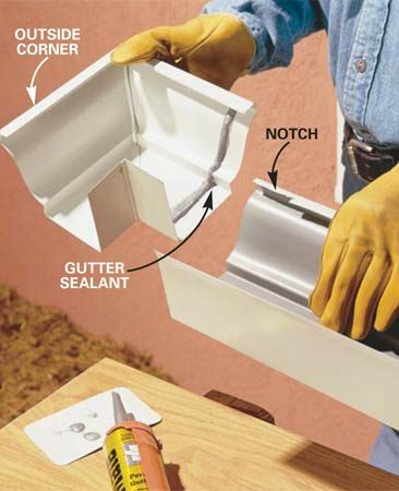 <b>Photo 3: Snap the sections together</b></br> Lay a bead of gutter sealant along the corner 1-1/2 in. back from the edge. Hook the front lip of the corner over the notched section of gutter and snap it over the gutter.