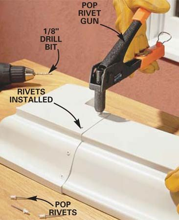 <b>Photo 4: Rivet the sections</b></br> Join the gutter to the corner with six rivets in the locations shown. Start by drilling a 1/8-in. hole (for 1/8-in. rivets) at the front of the gutter and installing the first rivet with the rivet gun. Now drill the remaining holes and install the rivets.