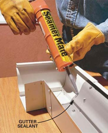 <b>Photo 5: Caulk the seam</b></br> Caulk the seam on the inside of the gutter with gutter sealant. Put a dab of sealant over each rivet.