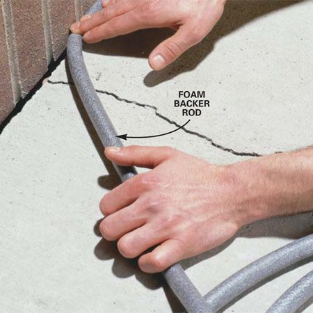 <b>Photo 1: Install backer rod</b></br> Use foam backer rod into the gap with your fingers. Set the rod 1/4 in. lower than the surface of the concrete.