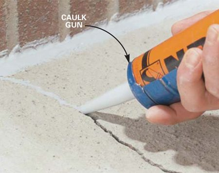 <b>Photo 3: Caulk narrow cracks</b></br> Caulk cracks 1/4 in. wide or less without using backer rod. Draw the gun down the crack, smoothing the caulk with the tip as you go.