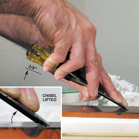 <b>Photo 5: Create a secondary edge</b><br/><p>Hold the sharpened primary bevel flat to the medium-grit stone, then raise it about 3/8 in. near the back of the handle as shown. Memorize this angle and move the blade forward and back along the stone to create a secondary bevel. Lubricate the stone as necessary to help flush away any minute metal filings. After several passes, repeat both the previous step and this step using a fine-grit stone until you have a super-sharp secondary edge.</p>
