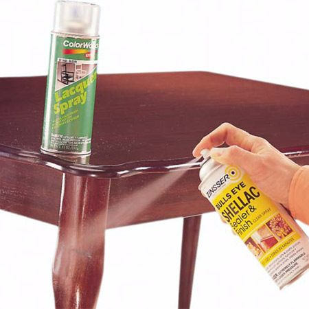 <b>Photo 4: Apply shellac</b></br> Spray the patch with two or three quick passes of shellac, then after it dries, a few quick passes of spray lacquer—either high gloss or satin, depending on your furniture's finish. <em>Never</em> apply lacquer or polyurethane/varnish directly over a putty patch; it will leave a permanently soft mess. Shellac will harden; however, the patch will remain somewhat pliable under the finish, so don't attempt this on a heavy-wear surface.