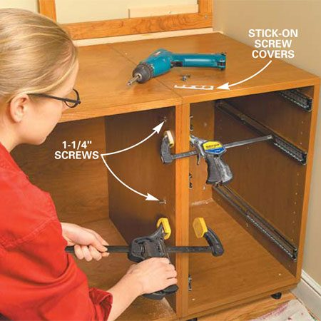 <b>Photo 9: Place the remaining base cabinets</b></br> Clamp the cabinets together, predrill and countersink screw holes, and drive three 1-1/4 in. screws. Push the cabinets into position, level with the cord trough and fasten with 1-1/2 in. screws.