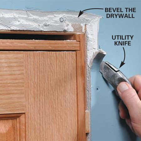 <b>Photo 2: Cut back the drywall</b></br> Trim back the drywall with a sharp utility knife until the molding no longer rocks when it's set in place against the jamb and drywall. Use a hammer to mash and flatten the drywall if necessary.