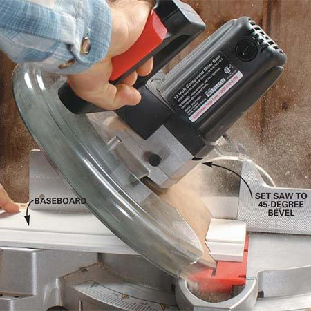 <b>Photo 1: Cut a bevel in the baseboard</b><br/>Cut a 45-degree bevel on the baseboard piece to be coped. This 12-in. compound miter saw allows us to cut up to 8-in. wide baseboards.