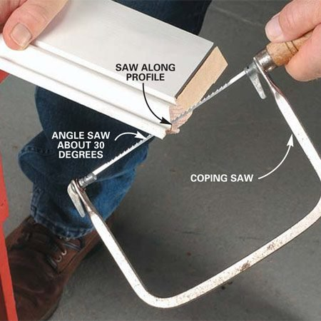 <b>Photo 3: Cut the profile with a coping saw</b><br/>Saw out the remaining profiled section with a coping saw. Tilt the saw to at least a 30-degree angle to create a back bevel for easier fitting.